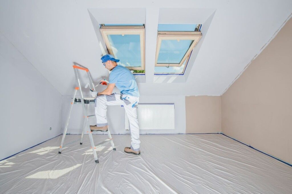 Painting contractor in St. Louis Park painting a room