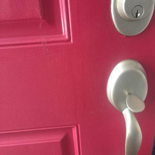 A red door freshly painted